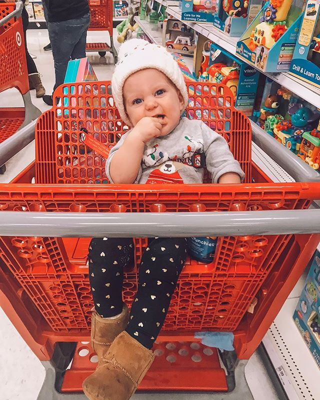 """Anna and I finished (well, and started...) our Christmas shopping tonight with Grammy! This girl was SUCH a little trooper.. shopping for 3+ hours! She literally just chilled back in the cart and snacked on her puffs, squealed at fellow shoppers, and played the """"drop her hat 80 times for mommy to pick up and laugh hysterically each time"""" game the whole time. She was the best little shopping buddy and never once made a fuss! Even still, I'm glad that's over! 😅🎁🎄 #lastminutechristmasshopping #targetwasamadhouse #5daystillchristmas"""