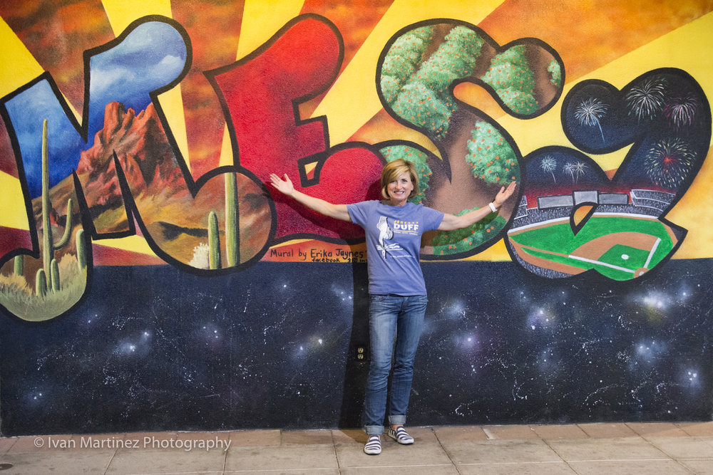 Jen Duff loves Mesa. Downtown Mural by artist, Erika Jaynes. Photo by Ivan Martinez Photography.