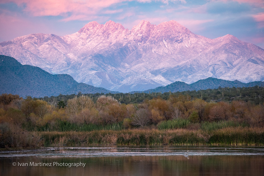 Snow covered Four Peaks at sunset time