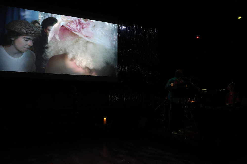 the film screens in a dark room