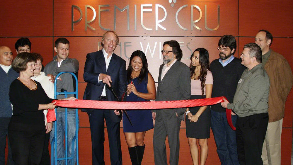 John Fox cuts the ribbon at the opening of Premier Cru's new location a few years ago.