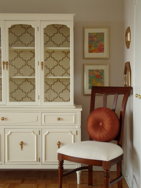 This incredible china hutch has been updated to perfection, while keeping it's delicate and antique feeling. The beautiful stenciling on the back of the hutch ties together the crisp white color of the exterior with the touch of gold on the handles and hinges. This was seen at  Honey Sweet Home .