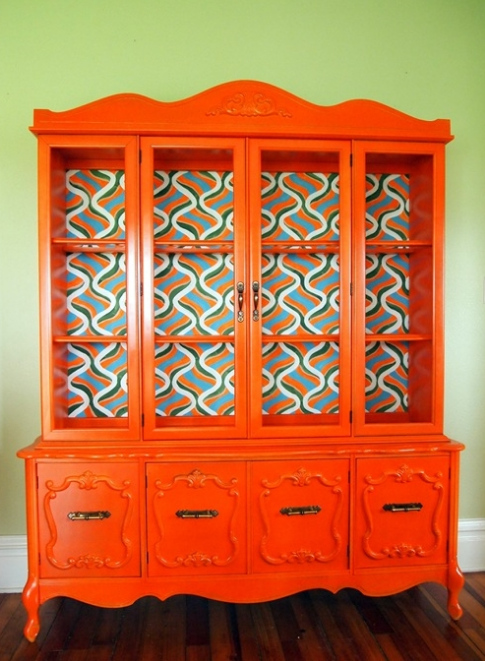 Never be afraid of a little color. This china hutch was painted an amazing shade of orange and the back was hand painted. This was seen at  Sawdust and Embryos .