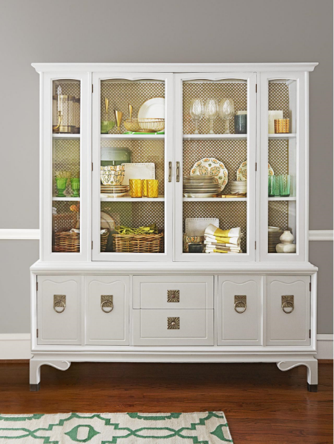 I think this china hutch speaks for itself. Painted a clean white, this allows for the brass hardware to really stand out. That hardware is complimented by the brass-toned radiator cover stapled to the back. This was seen at  HGTV .
