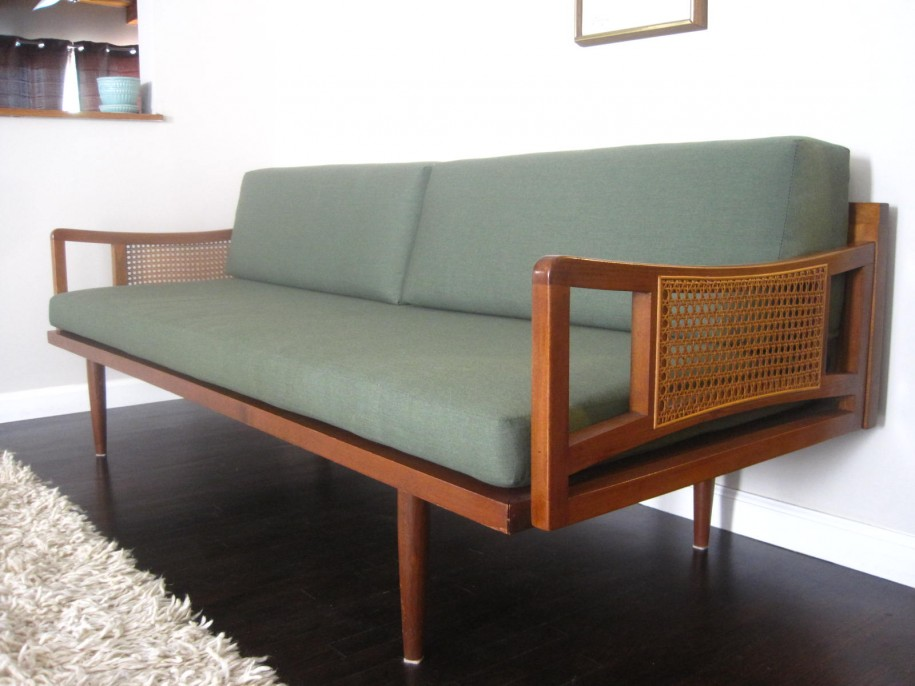 Mid-century modern sofa with traditional hole to hole strand caning on sides.