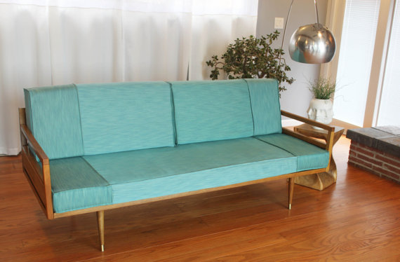Fascinating Mid-century modern sofa with wood frame.