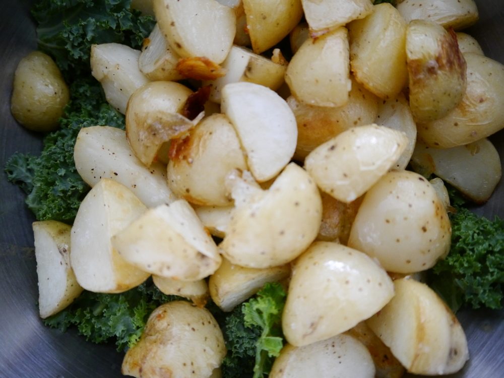 I put the chopped kale in the bowl with the dressing and added the potatoes straight from the oven so that the heat would wilt the greens just a little.  Then I mixed the kale and potatoes until they were evenly coated with dressing before addng the lentils and parsley .