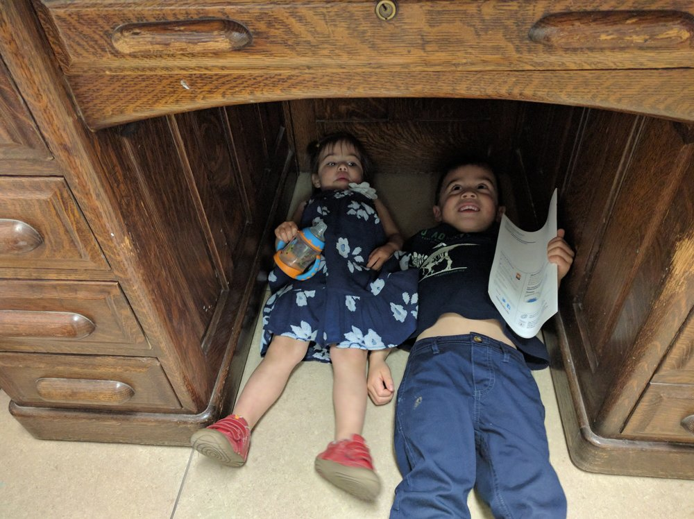 Of course hiding under this old desk was more fun than all of the fancy ice cream churners in the world.