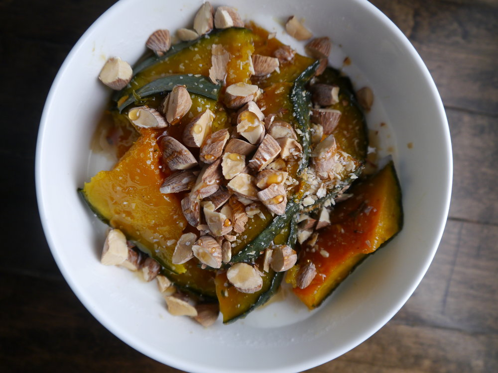 Greek yogurt topped with roasted Kabocha, chopped almonds and honey. A beautiful, nutritious breakfast.