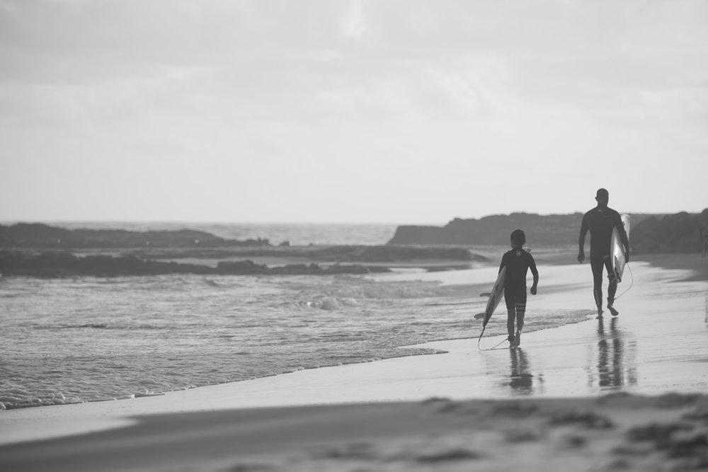 dad son surfing portrait photo