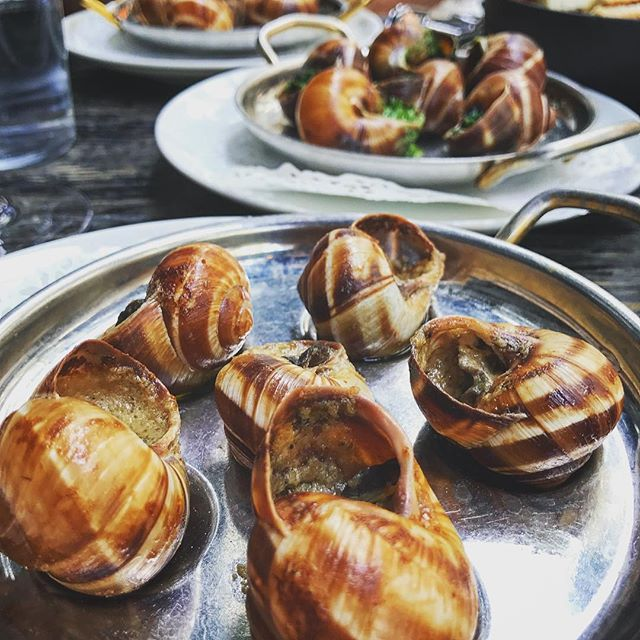 I've got snails for miles and miles. The amazing @escargotmontorgueil has been dishing out these Burgundy beauties for over 200 years.  Impossible to pick between fois gras, truffle butter, or au traditional so we ate them all. C'est magnifique! #parisfood #frenchfood #snailsofinstagram #escargot #reallyslowfood #foisgras