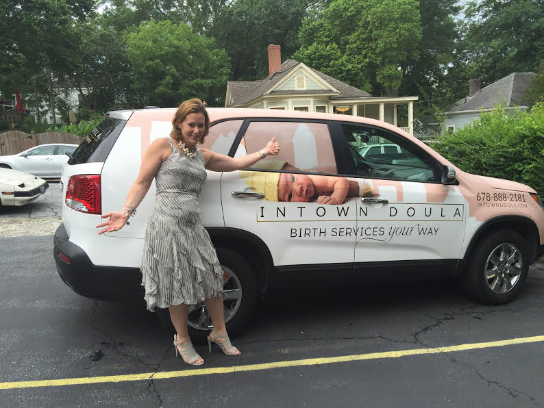 Debbie Aglietti of ProDoula posing with the Intown Doula car!