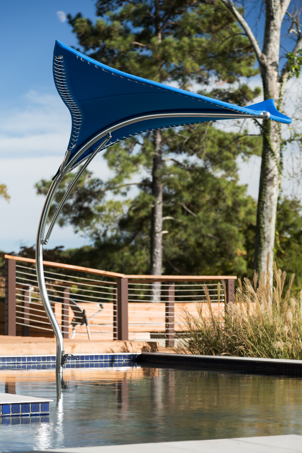 Alexander Modern Homes recently added these Manta outdoor umbrellas by Tuuci as part of their offerings. I've never seen a more impressive, and solidly constructed outdoor umbrella. They are expensive but you can really see a major difference in style and craftsmanship!