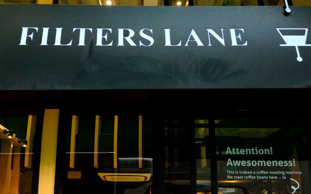 Filters Lane's shopfront, complete with in-house roaster right there in the window