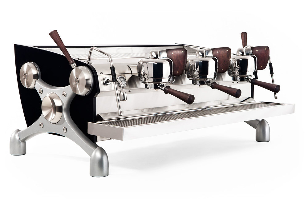 A fairly standard Slayer espresso machines. Note the tough build and the manual 'paddle' pressure controls over each portafilter (the handle-y bit).