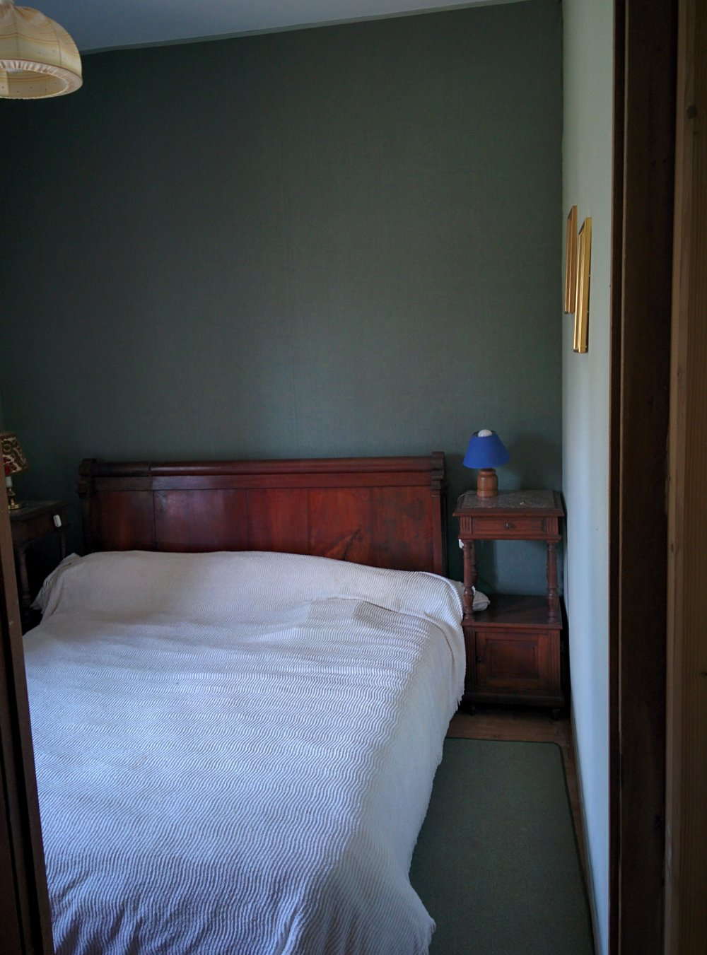 This double bed and a big old wardrobe were in the second half of the room, behind the partition wall.