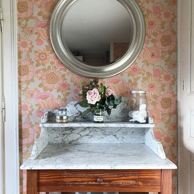 I kind of love, kind of hate this 70s wallpaper. It won't be staying long term, but for now this is how my bathroom looks. This marble topped wash stand was left in the house by the previous owners and I love it. One day it will be part of a glorious bathroom with a tub I can soak in - until that time it makes our makeshift bathroom a bit prettier.