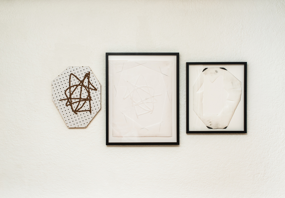 Untitled     pegboard and paper 2014