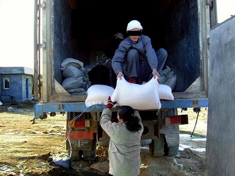 food aid truck unloading.jpg