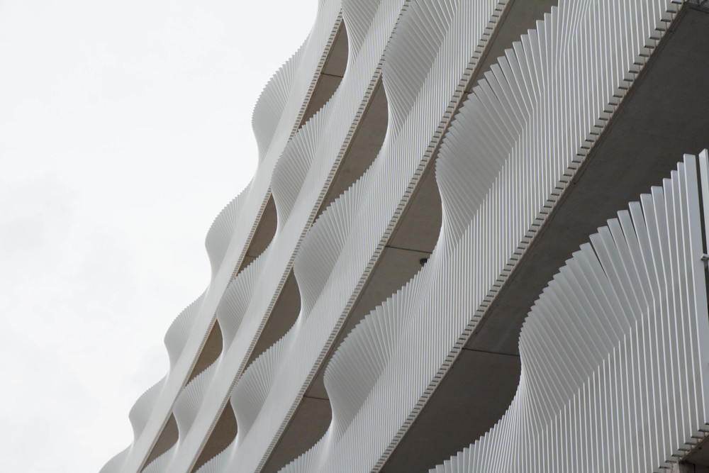 White-capped waves in a city tied to water or beautifully undulating balconies?