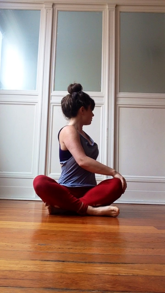 Come into a cross-legged position. Inhale, lifting both arms toward the sky. Twist toward the left, placing your right hand on the left knee and placing your left hand behind you on the ground. Inhale to lengthen through the spine and lift through the crown of the head. Exhale to twist deeper, first at your navel center then your mid back then your upper back and finally through your neck and gaze. Stay for five breaths, continuing to lengthen on the inhale and twist on the exhale. After five breaths, take it to the other side, twisting to your right and placing your left hand on your right knee.