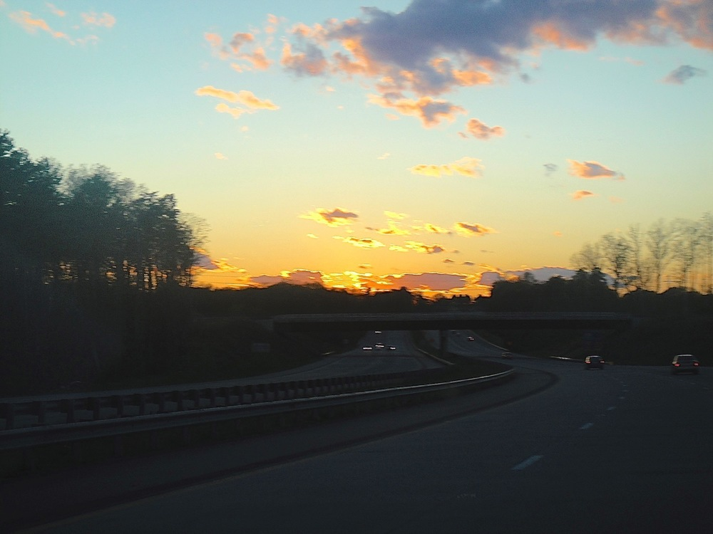 Original image - a gorgeous sunset over a dark, gray highway