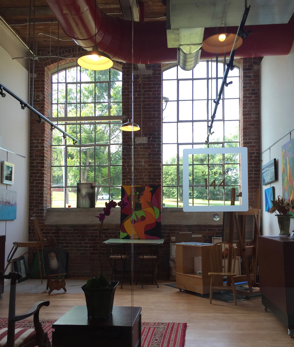 Suite Art 144 at Revolution Mill Greensboro is an art studio and gallery exhibiting the work of  Jerry Cartwright , Alice Bachman, Phyllis Sharpe,   Marjorie Smith , and  Kathryn Troxler .  Phyllis Sharpe and Kathryn Troxler also paint in the studio which opened in July of 2016.