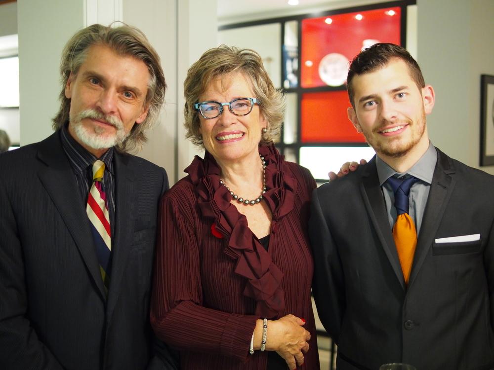 Carol with Paul Haslip and Marcio Morgado of HM&E Design Communications.