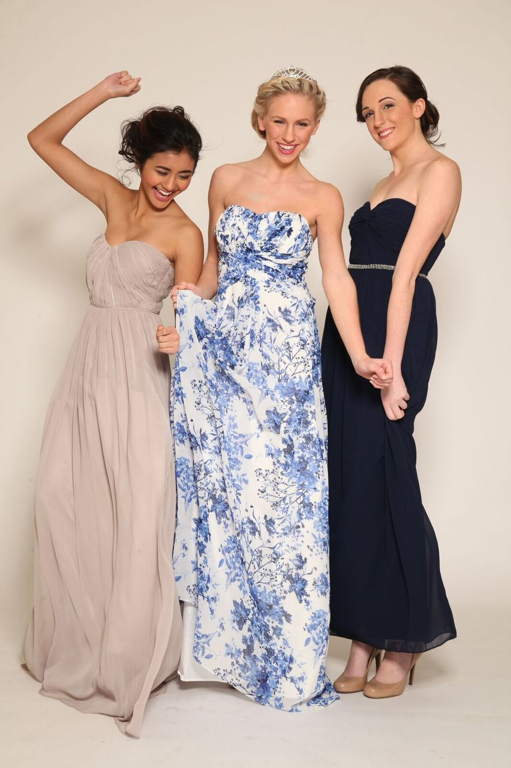 From Left to Right: Mauve Strapless Gown with Satin Piping Detail $89 // Floral Strapless Chiffon Gown $89 // Navy Strapless Chiffon Gown With Waistline Beading Detail $89