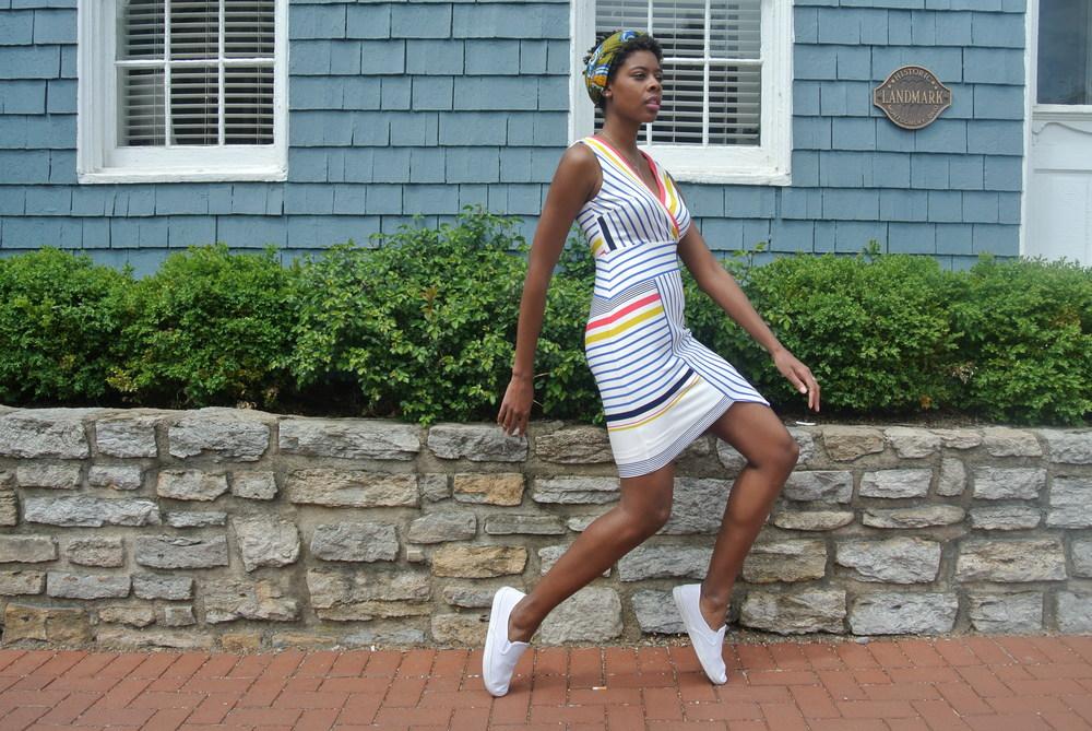 I love the asymmetrical hem on this rainbow striped dress.