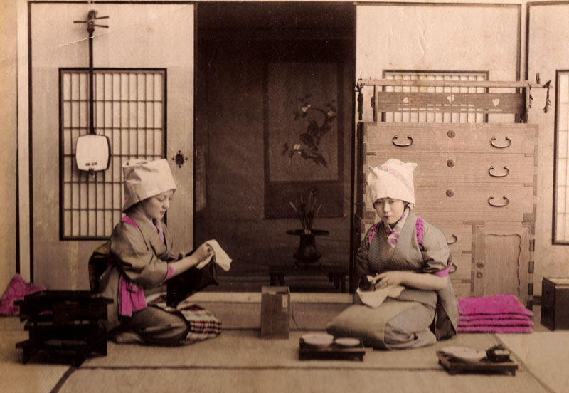 Late Meiji Albumen photo of girls cleaning.   The tansu shown has the latest commercial style hardware for the time.