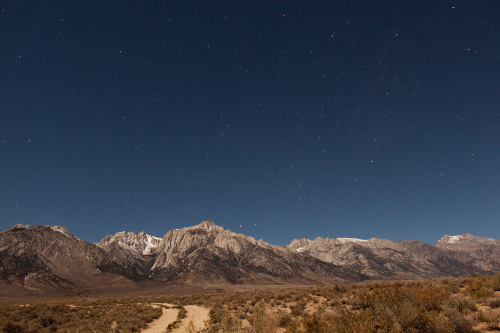 Starry night in Lone Pine, California taken with a 30-second exposure by placing my camera on top of the car hood.