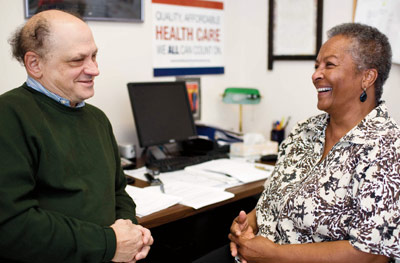 Jon Moscow (left) and Sandra Ford share memories and a laugh in 2008.