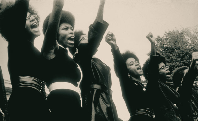 Women saluting, 1968, photo by Ruth Marion Baruch and Pirkle Jones