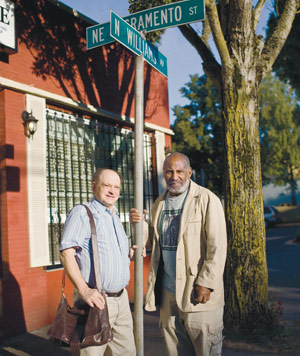 Jon Moscow '69 (left) and Kent Ford in 2008, on the street corner where the Fred Hampton Memorial People's Clinic once stood.