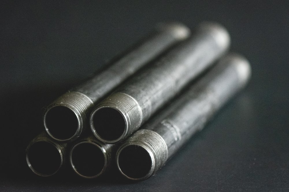 Black steel plumbing pipes 1/2 inch diameter and 8 inches long