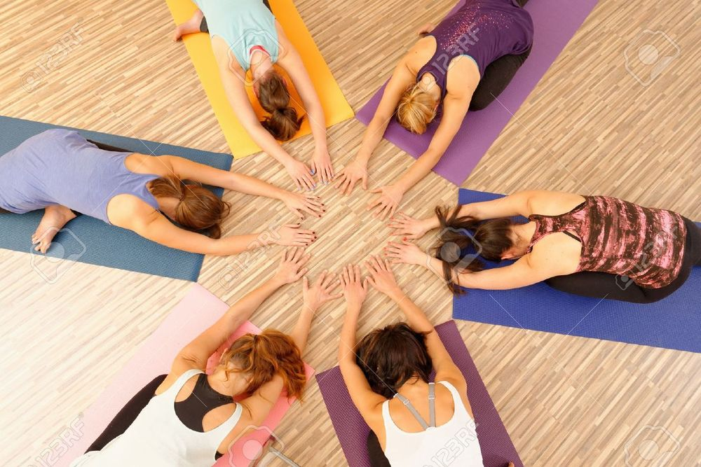 30112185-Hands-of-the-women-forming-circle-at-Yoga-class-Stock-Photo-group.jpg