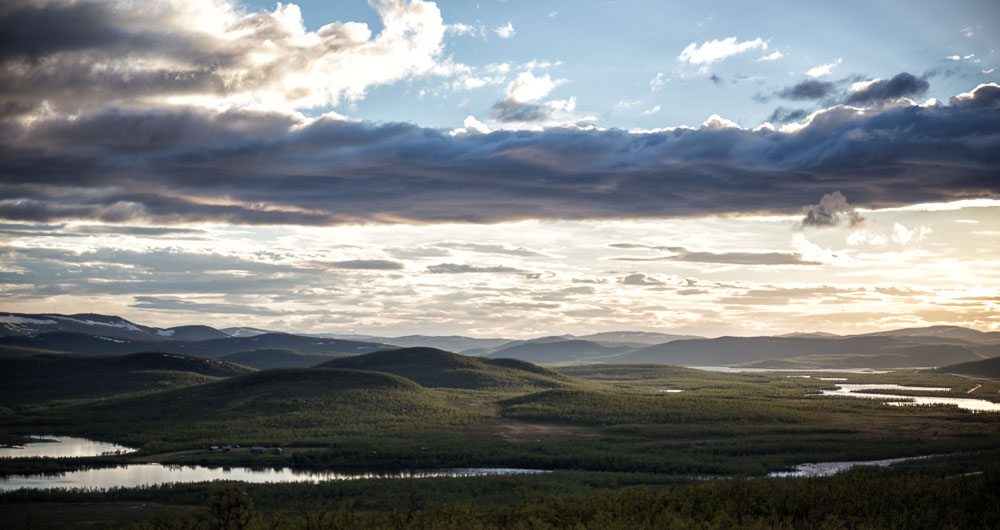 Rolling hills and fells of North Finland by the border river.