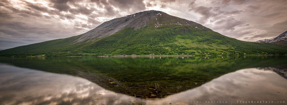 A fell reflecting off a fjord in Nordkjosbotn, Norway.