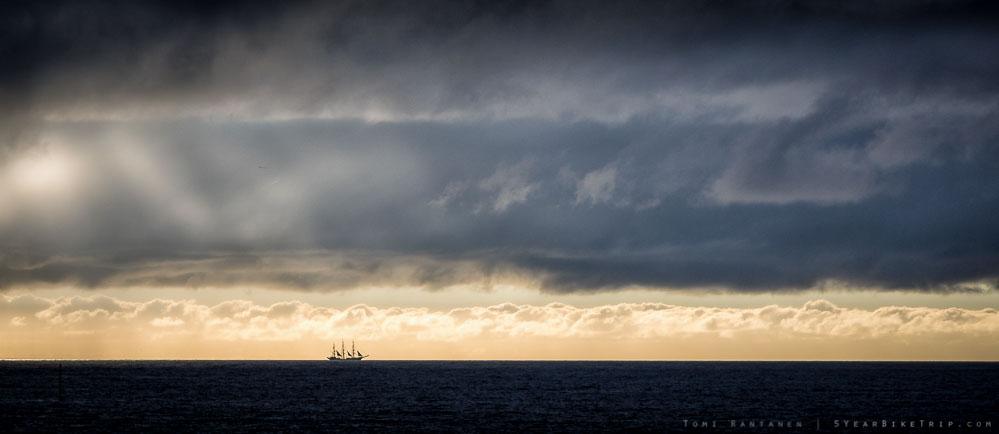 A single sailbot in the horizon.