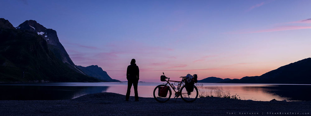 Bicycle tourer at sunset.