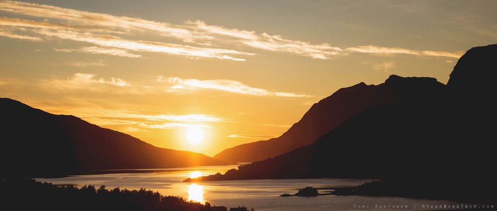 Sunset between mountains by the fjords in Norway.