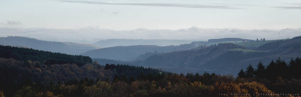 Typical view in Luxembourg:Rolling hills and forest.
