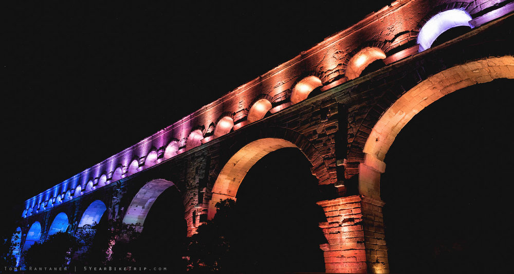 The lights of Pont du Gard at night.