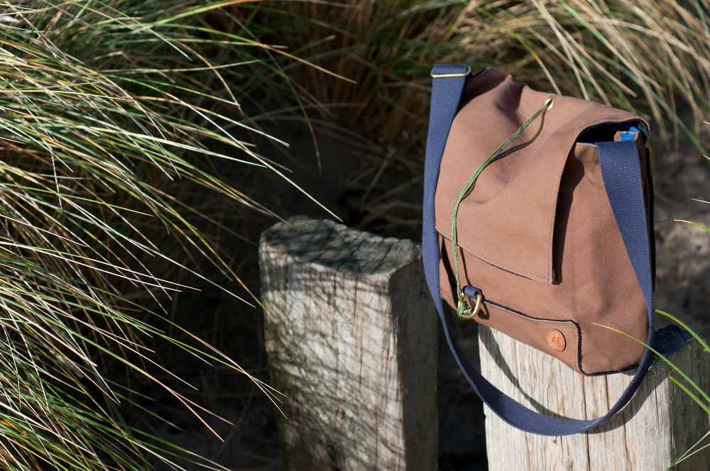 The proofed duck canvas pack is fully lined, with internal slip pockets and double lapped seams for durability and strength