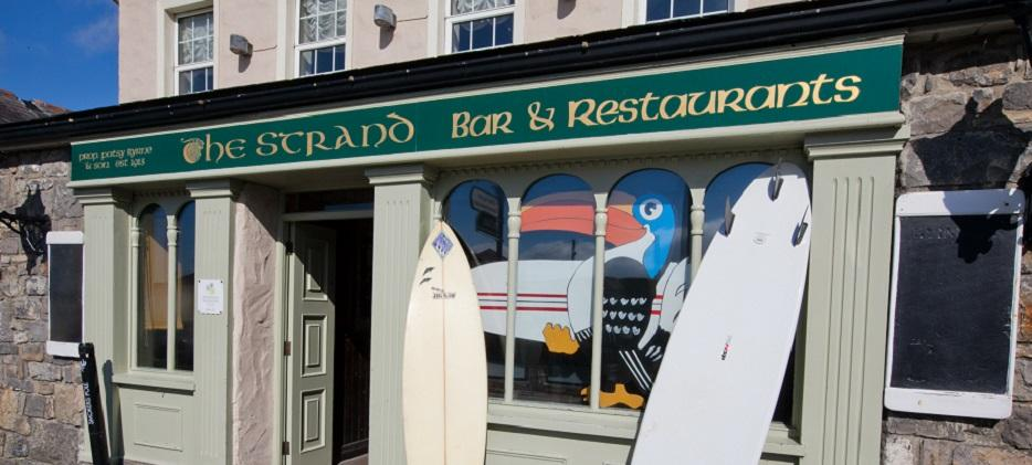 The-Strand-outside-shot-with-surfboards-panoramic.jpg