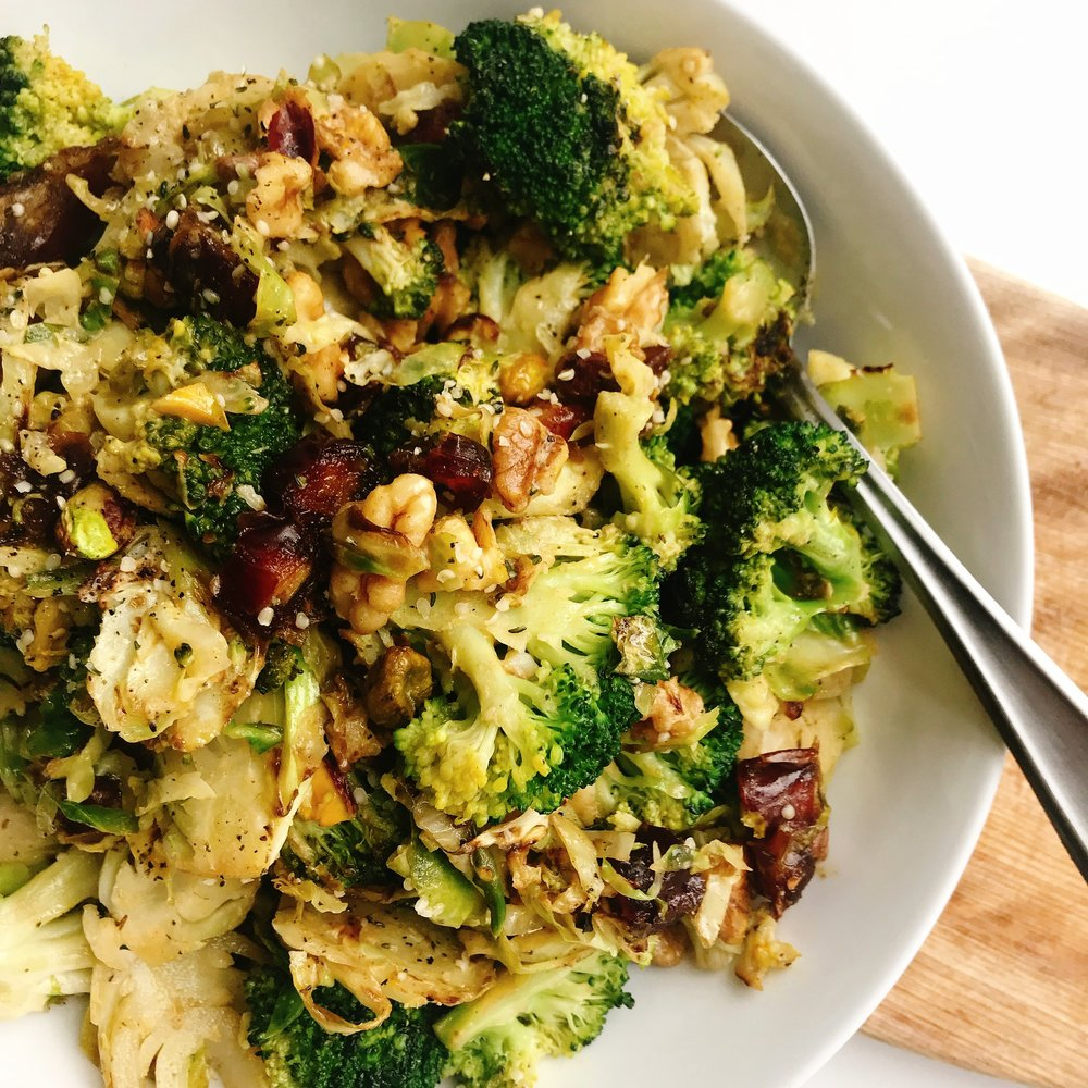 A light crunchy salad filled with broccoli, brussels sprouts, chopped dates, nuts with a tangy dressing that takes less than 15 minutes!