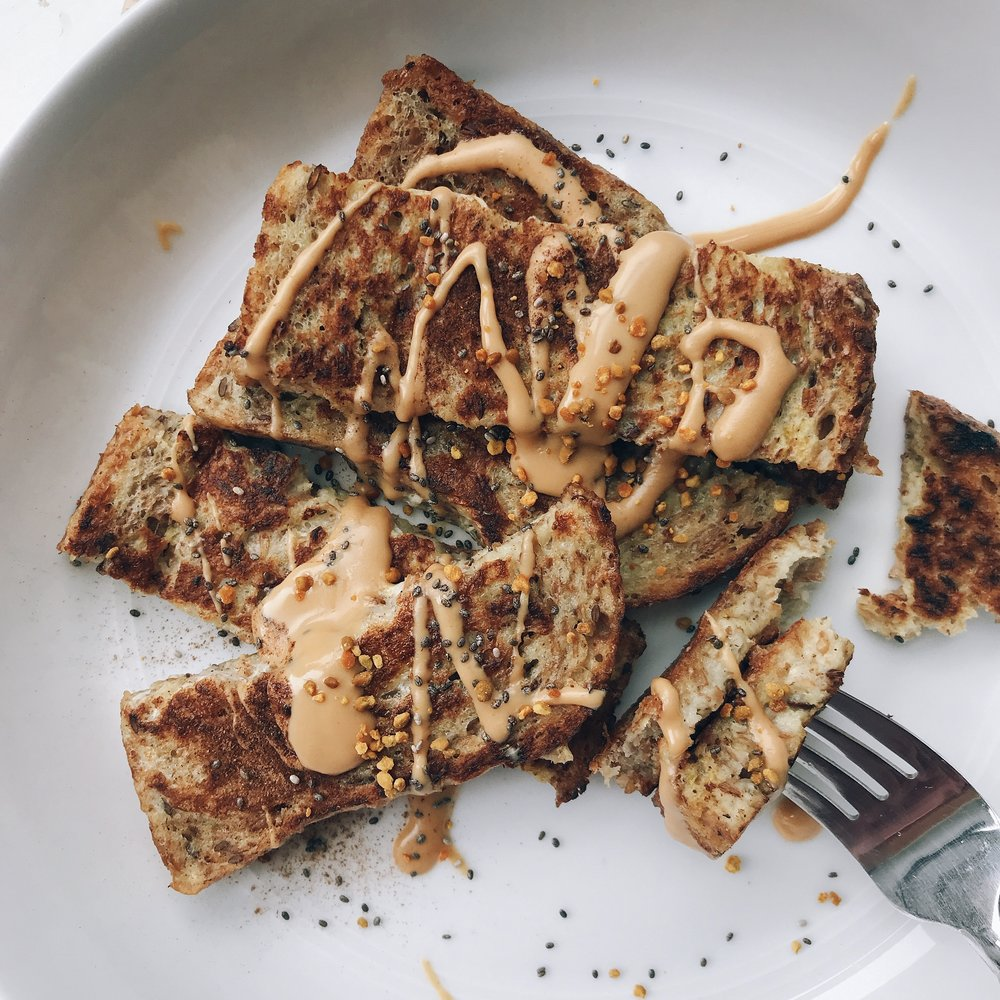 Crispy french toast sticks drizzled with maple almond butter, chia seeds, & bee pollen for a breakfast or brunch in less than 10 minutes!