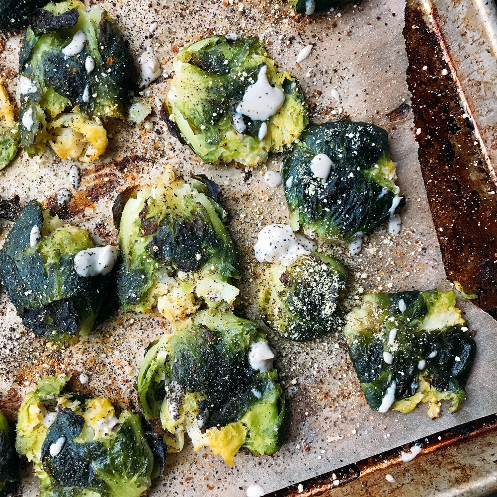 crispy, cheesy (dairy free!) smashed brussels sprouts that are so addicting!