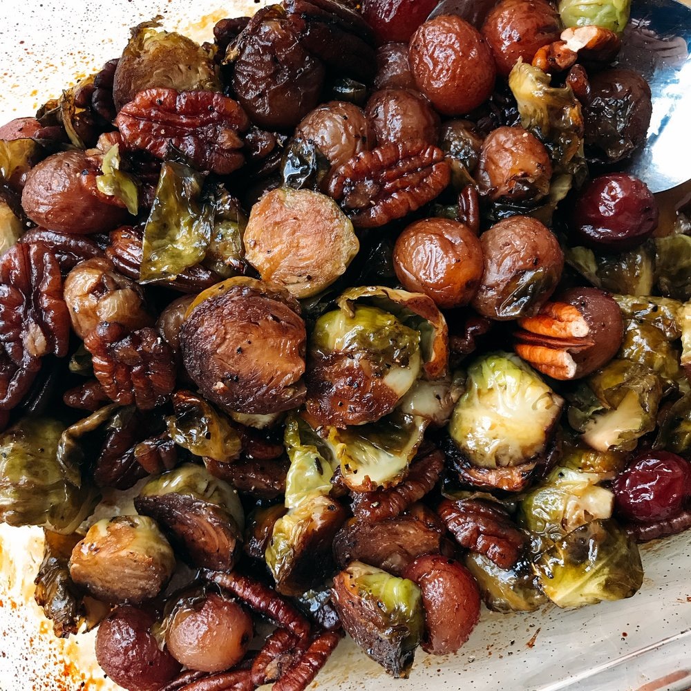 Roasted brussels sprouts and grapes with a maple syrup balsamic glaze for the most delicious thanksgiving side dish; a little sweet and savory.